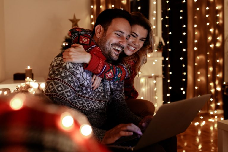 Couple excited about their new purchase online