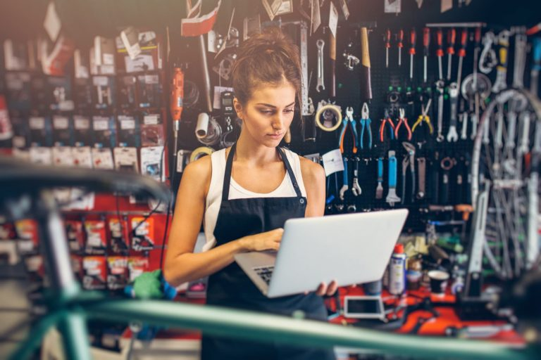 woman bike mechanic replying to email