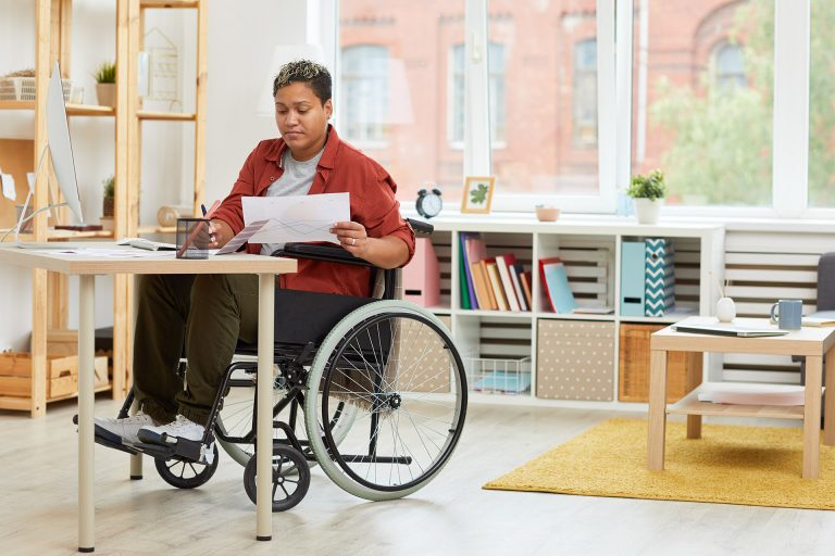 Woman in wheel chair reviewing papers