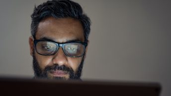 Man using laptop late night