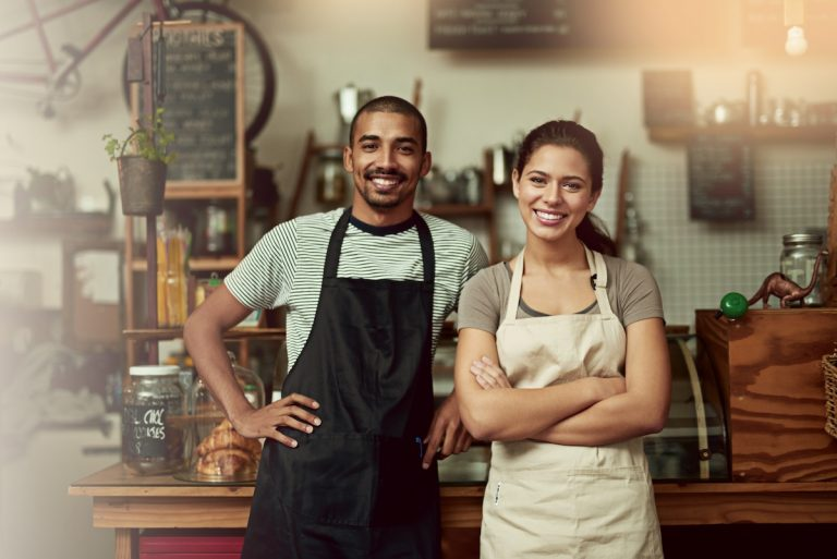 Portrait of a confident young man and woman working together to keep their business open