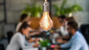 Lightbulb above a business team
