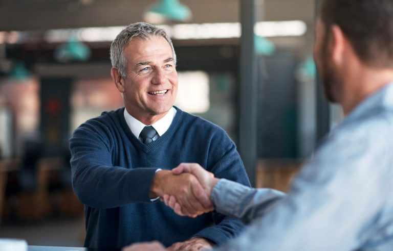 Entrepreneur shaking hands with a mentor