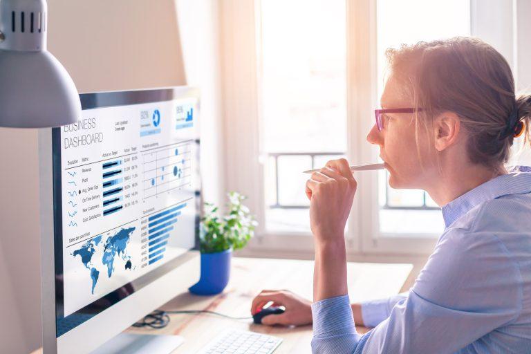 Business woman analyzing business metrics