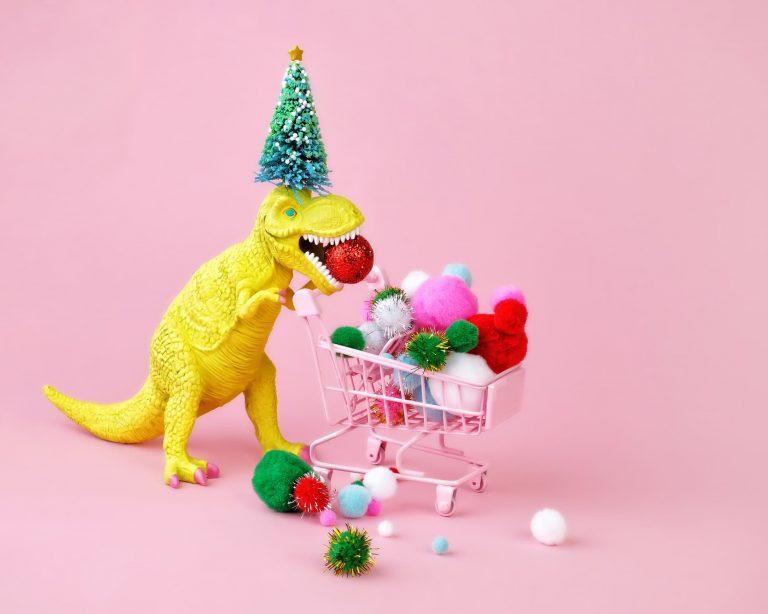 Yellow holiday dinosaur on a pink background