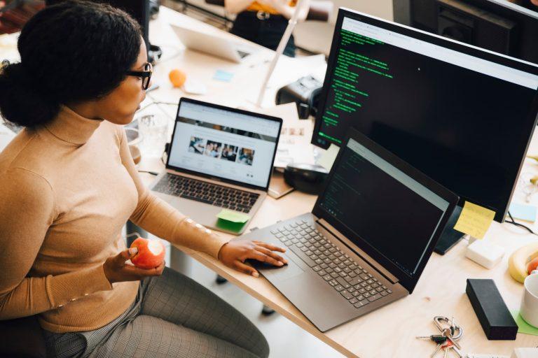 Black businesswoman coding her sitemap